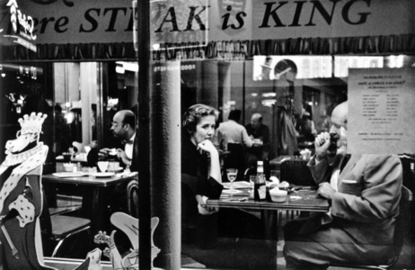 Couple in cafe window, Times Square, New York City