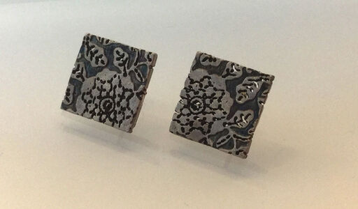 Small, Dark Brown Sterling Silver Stud Earrings With Relief