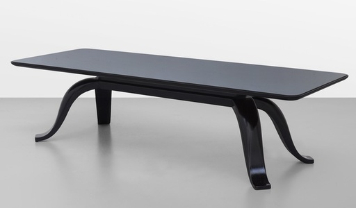 A coffee table, made of black wood and mirrored crystal.