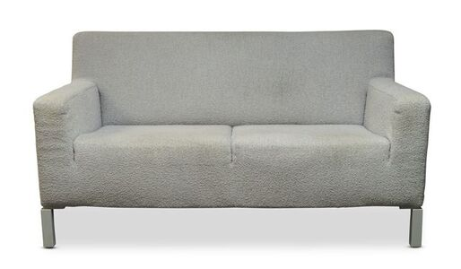 a white upholstered two seater sofa, together with three matching lounge chairs