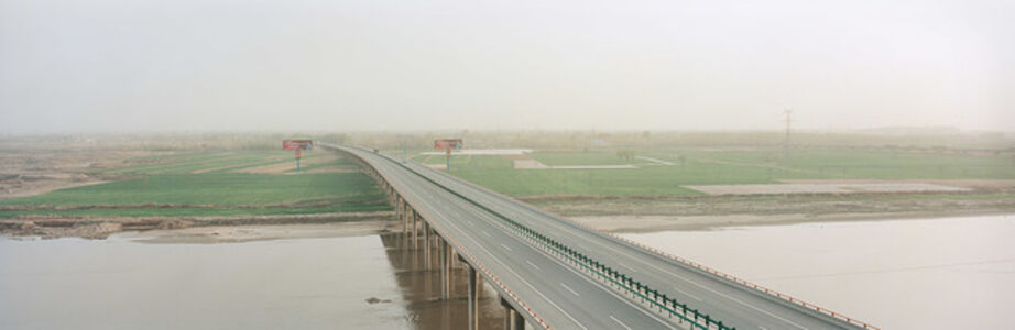New highway, agricultural land and the Yellow River. Lanzhou, China.