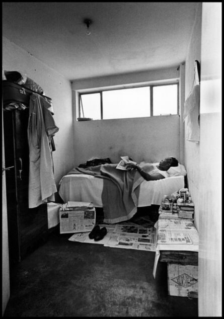 Ernest Cole, 'Newspapers are her carpet, fruit crates are her chairs and table, South Africa', 1960