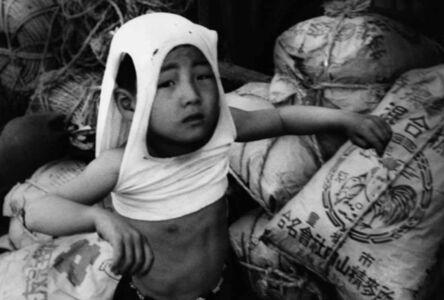 William Klein, 'Nippori suburb. Sacks of grain, rope, a boy in an undershirt-helmet, Tokyo', 1961