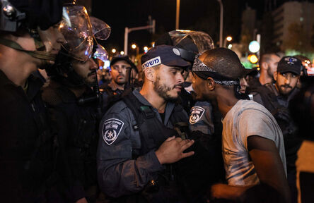 Avishag Shaar Yashuv, 'Ethiopian Israelis confront police officers during a protest near Azrieali Towers in central Tel Aviv. 10 Protesters were arrested. June, 2015', 2015