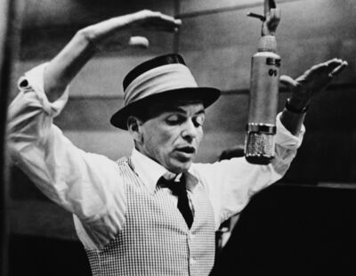 """Murray Garrett, 'Known as """"The Voice"""" Here Frank Sinatra Becomes """"The Conductor"""" During a Capitol Records Recording Session in Hollywood', ca. 1953"""
