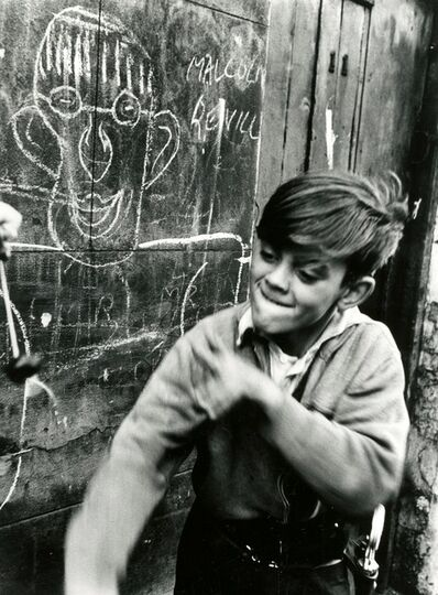 Roger Mayne, 'Boy playing conkers, Addison Place ', 1957-printed 1987
