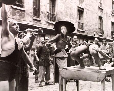 Richard Avedon, 'Elise Daniels with Street Performers, Suit by Balenciaga, Le Marais, Paris, August', 1948