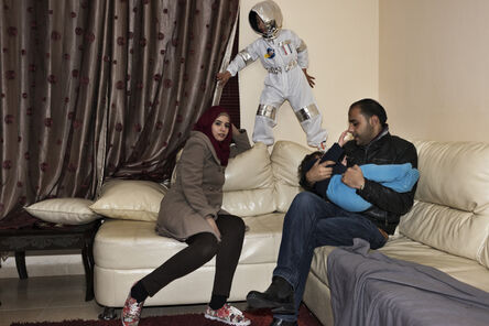 Tanya Habjouqa, 'Hussein, 8, wants to be an astronaut. Mohammad and Mariam Hussein at their home in Jalazoon refugee camp outside Ramallah', 2017