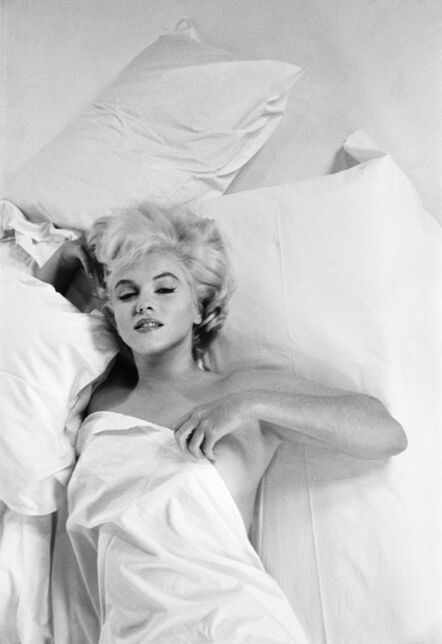 """Eve Arnold, 'US actress Marilyn Monroe resting between takes during a photographic studio session in Hollywood (Paramount Gallery), for the making of the film """"The Misfits"""". Directed by John Huston (USA). Nevada. Screenplay by Arthur Miller (USA)', 1960"""
