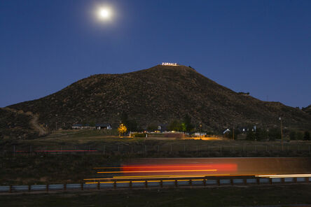 """Lauren Greenfield, 'Lauren Greenfield """"FOR SALE"""" is written in Christmas lights on a bluff above I-15 in Southern California's troubled Inland Empire, where real estate values plummeted', 2009"""
