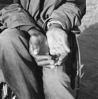 David Goldblatt, 'Crippled by a stray bullet from an argument in which he had no part, a former gold-miner sits in a wheelchair and begs at a crossroad on the Johannesburg-Cape Town highway, while pursuing winning numbers for the national lottery. Springsfontein. 7 August 2003', 2003