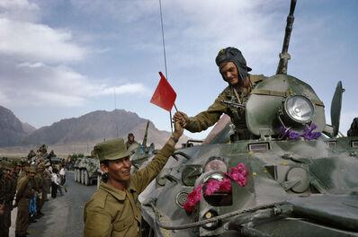 Robert Nickelsberg, 'Afghan soldier hands red solidarity flag to Soviet officer', 2010