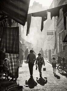 Fan Ho, ''Strolling to Tai Ping Shan Street 漫步太平山街' Hong Kong', 1950/60s