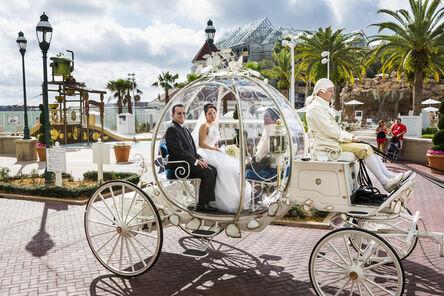 Lauren Greenfield, 'Christina, 21, en route to her wedding in Cinderella's glass coach, Walt Disney World, Orlando, Florida', 2013