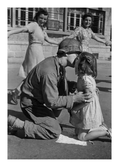 Tony Vaccaro, 'Kiss of Liberation: : Sergeant Gene Costanzo kneels to kiss a little girl during spontaneous celebrations in the main square of the town of St. Briac, France, August 14, 1944 '