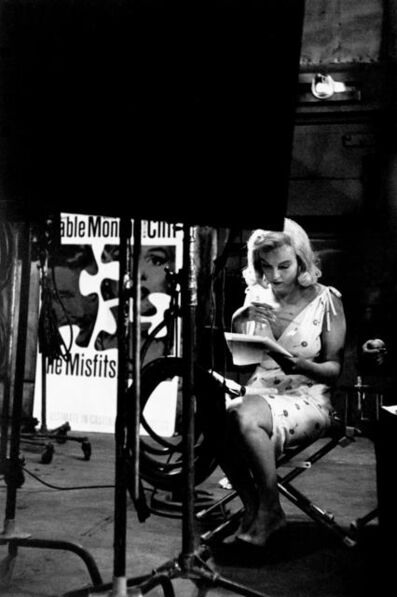 Eve Arnold, 'Marilyn Monroe looking at layouts for posters to advertise the Misfits. Nevada, USA. ', 1960