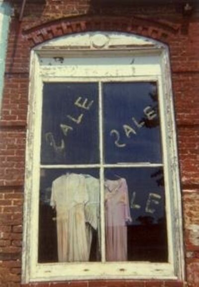 William Christenberry, 'Window with Sale Dresses, Uniontown, Alabama', 1974