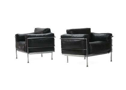 Style of Le Corbusier, 'A pair of Modern black leather and chrome chairs'