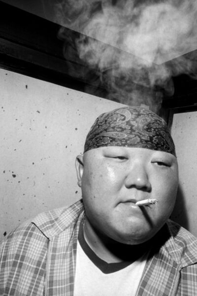 Bruce Gilden, 'Man smoking cigarette. Go', 1999