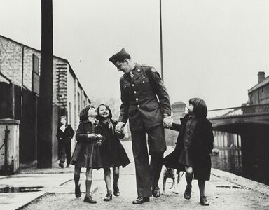 "Robert Capa, 'London, England, American soldier with war orphans ""adopted"" by his unit', 1943"