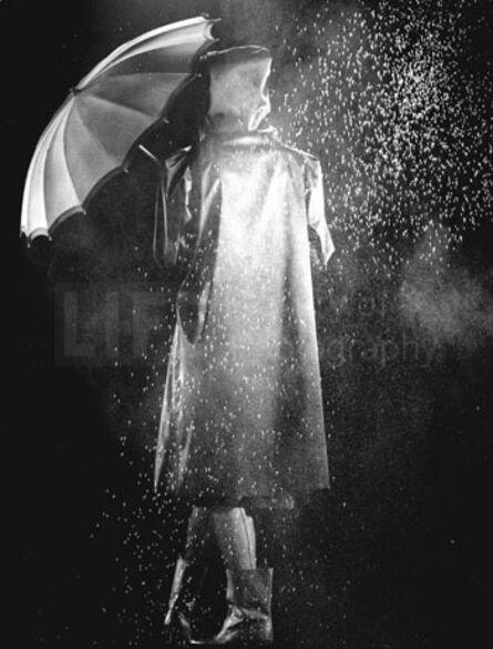 Gjon Mili, 'Fashion Shot of Model in Raincoat Holding Umbrella', 1943