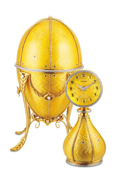 Asprey, 'A very fine and rare yellow gold, enamel, diamond and pearl-set egg-shaped clock with yellow gold stand and presentation box', Circa 1991