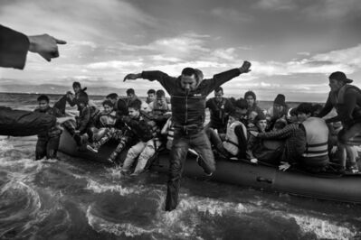 Ashley Gilbertson, 'Volunteers help refugees, primarily from Syria, Iraq and Afghanistan, disembark on the island of Lesbos, Greece, near Turkey.', 2016