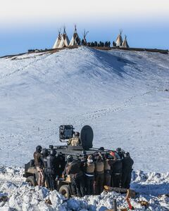 Ryan Vizzions, 'Protesters face off with police and the National Guard on February 1, 2017, near Cannon Ball, North Dakota.'