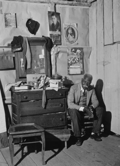 Jack Delano, 'Untitled (Man seated next to his dresser)', 1940