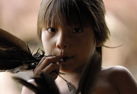 Attila Lorant, 'Young Yanomami Child playing a Game with a Feather', 2005