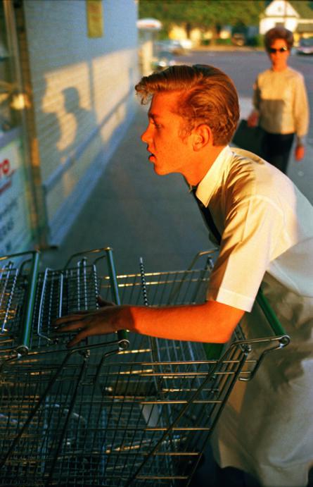William Eggleston, 'Untitled [Supermarket boy with carts], Memphis', 1965