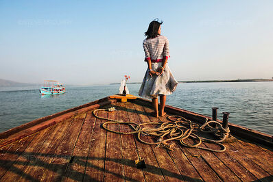 Steve McCurry, 'Girl on Ship Prow, Burma', 2011