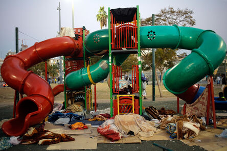 Daniel Bar On, 'African asylum seekers sleep in a public playground in Southern Tel Aviv. Many asylum seekers arrived at the southern neighborhoods of the city, leading to tensions with local residents. February, 2014', 2014