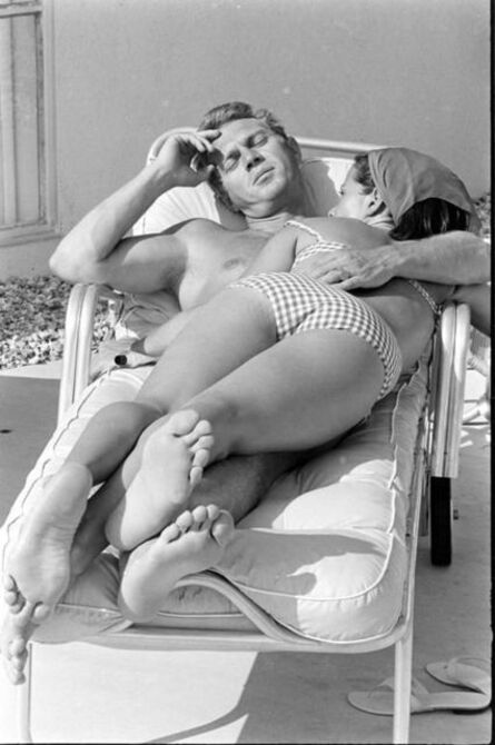 John Dominis, 'Steve McQueen and his wife, Neile Adams, laying on a chair, California', 1963