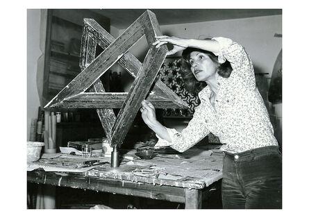 Monir Farmanfarmaian, 'Monir Shahroudy Farmanfarmaian in her studio working on Heptagon Star, Tehran, 1975', 1975