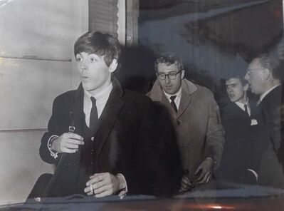 Daniel Frasnay, 'Paul McCartney behind him with glasses probably Mal Evans', 1963 -64