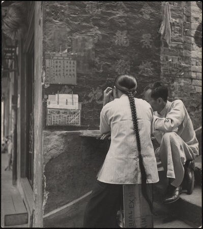 Werner Bischof, 'The public letter writer at his stand on the streets in Hong Kong', 1952