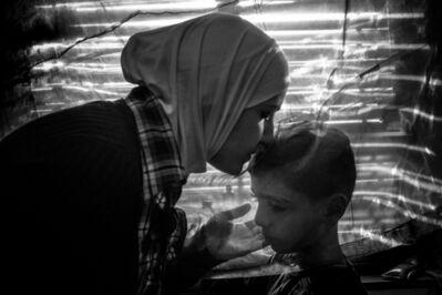 Ashley Gilbertson, 'Amira Raslan conforts her son Aur, Berlin, 2016. The family fled Syria for safty in Germany in 2015'