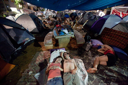 Tali Mayer, 'Activists lie in a tent camp on Rothschild Boulevard, a central avenue in Tel Aviv. The camp was erected in protest of the rising housing prices. The initiative ignited a wave of mass protests for social justice which lasted for several months. July, 2011', 2011