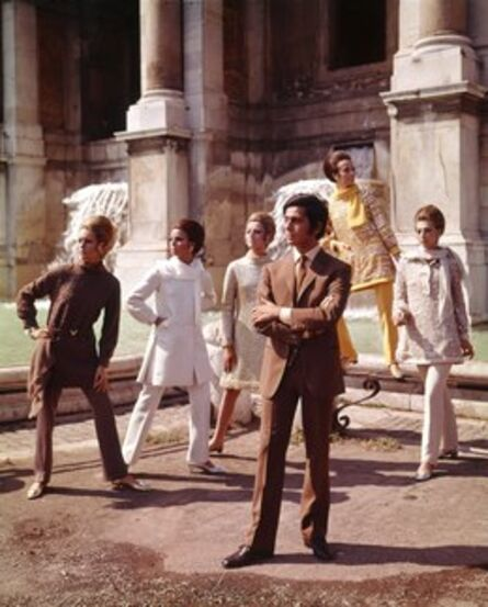 'Valentino posing with models nearby Trevi Fountain. Rome', 1967