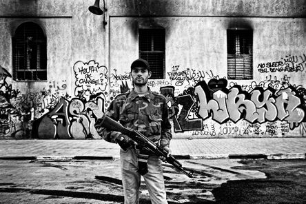 Zied Ben Romdhane, 'A rebel secures the building of the temporary government. Benghazi, Libya', 2011