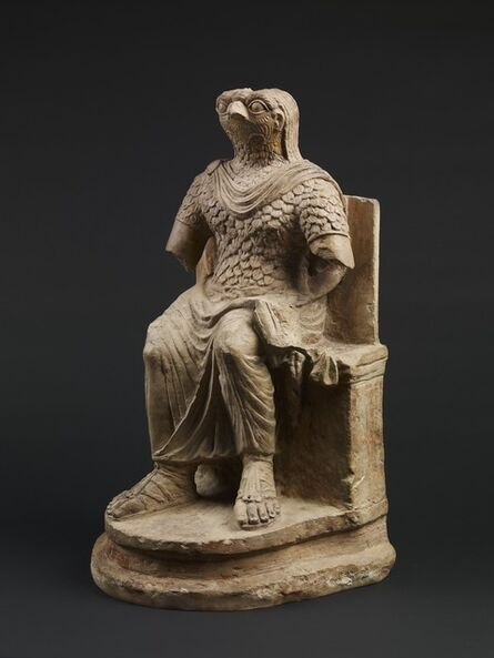 'Seated figure of the Roman god Horus, wearing Roman military costume', 1st-2nd century AD