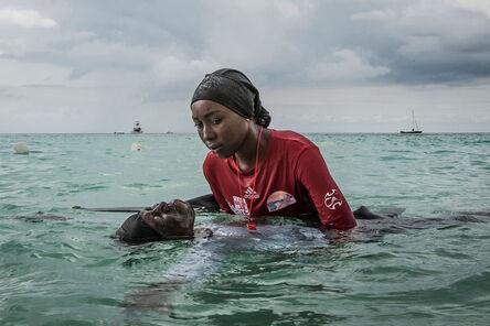 Anna Boyiazis, 'Swim instructor Siti, 24, helps a girl float in the Indian Ocean off of Nungwi, Zanzibar, 2016', 2016