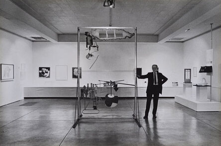 Julian Wasser, 'Marcel Duchamp standing with The Large Glass, Duchamp Retrospective, Pasadena Art Museum,', 1963