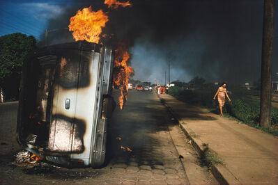 Susan Meiselas, 'NICARAGUA. Managua. Car of a Somoza informer burning in Managua.', 1978-1979