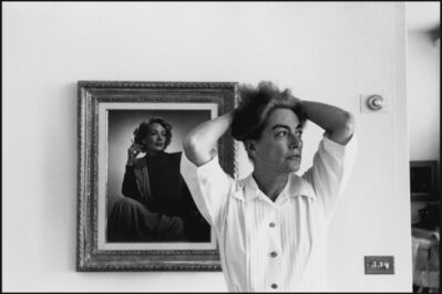 Eve Arnold, 'Joan Crawford, actress trying to remember her lines during a rehersal at home. Behind her is Joan as she was in Mildred Pierce. California, USA.  ', 1959