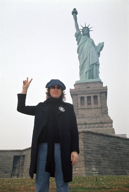 Bob Gruen, 'John Lennon in front of The Statue of Liberty, New York City', 1974