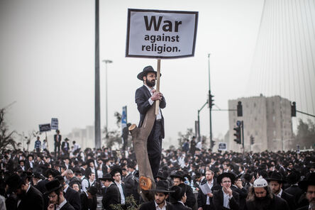 Emil Salman, 'Tens of thousands of Ultra-Orthodox Jews protest against a new law which requires much larger numbers of men from their community to serve in the military. All Israeli citizens are required, at 18, to serve, yet for years, exemptions were extended over religious grounds; the new law aimed at changing this disparity. March, 2014 ', 2014