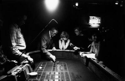 Eve Arnold, 'Marilyn Monroe gambling with John Huston (Reno, Nevada)', 1960