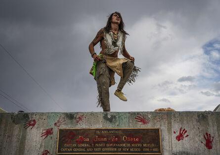 Gabriela E. Campos, 'Than Tsídéh, 19, of the Ohkay Owingeh Pueblo dances on the empty platform where a statue of Juan de Oñate was removed, Rio Arriba county, New Mexico, June, 2020', 2020